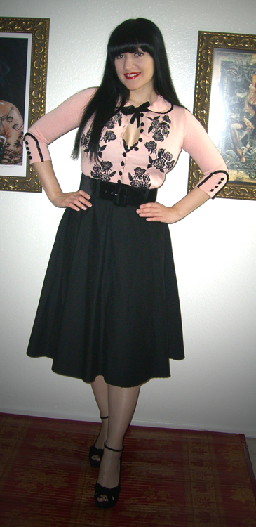 14da5396d22 I just happened to run  Wheels   Dollbaby  through an Ebay search and the  glorious peach and black version of the cardigan came up.